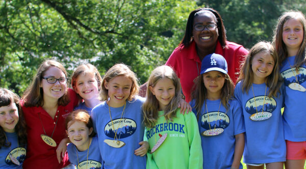 Girls arrive at summer camp