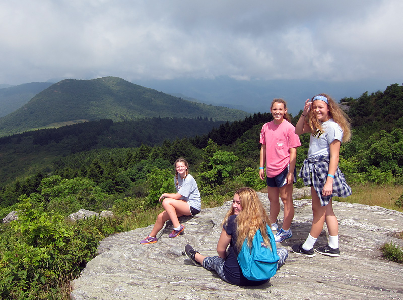 Girls mountain top hiking