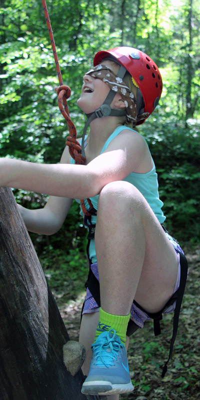 Blindfolded Girl Rock Climbing