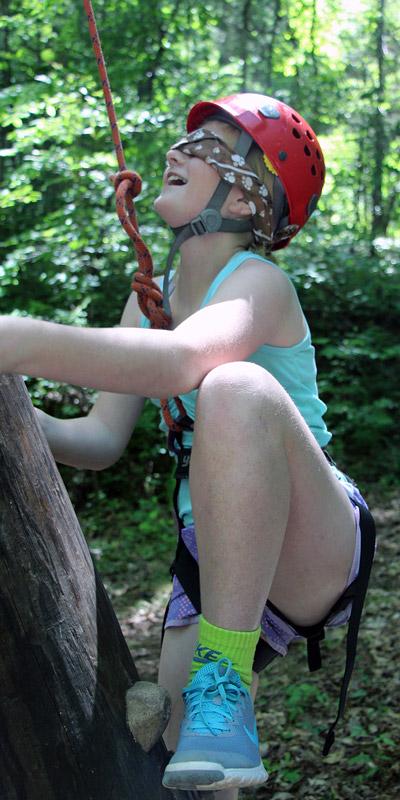 Blindfolded Girl Rock Climbing