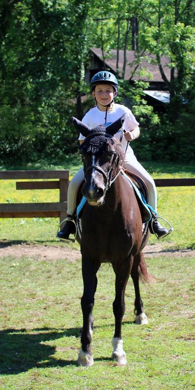 Camp Girl Riding Horse