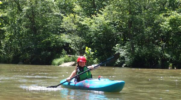 Girl Kayaking down river