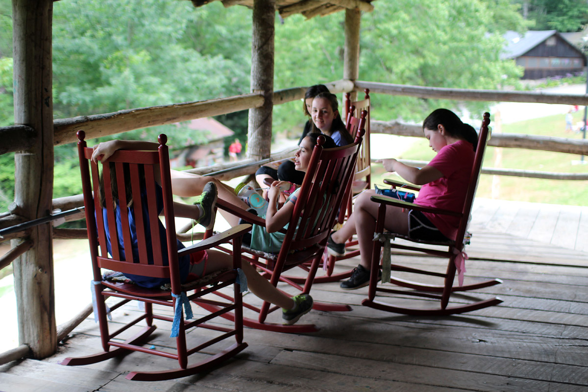 Camp girls talking on porch