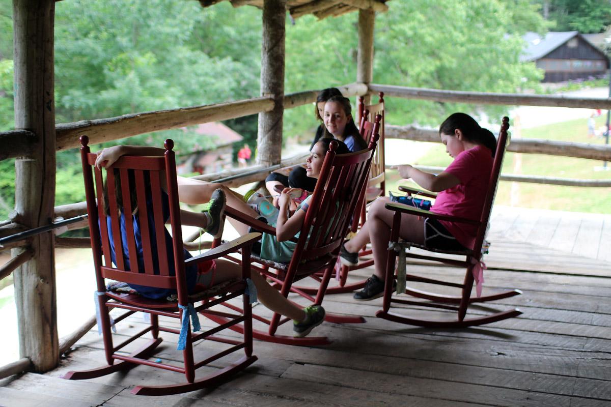 Camp girls talking on porch