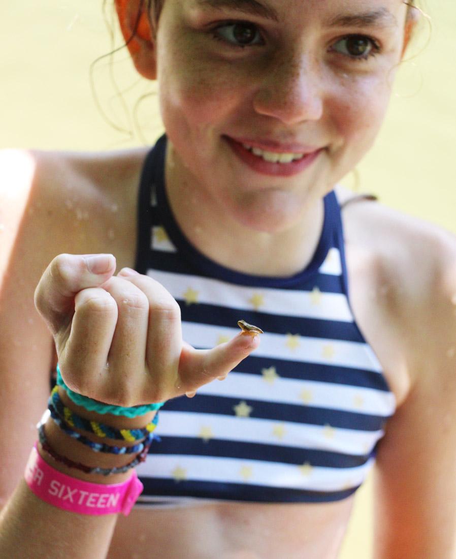Girl Holding Small Tadpole on Finger