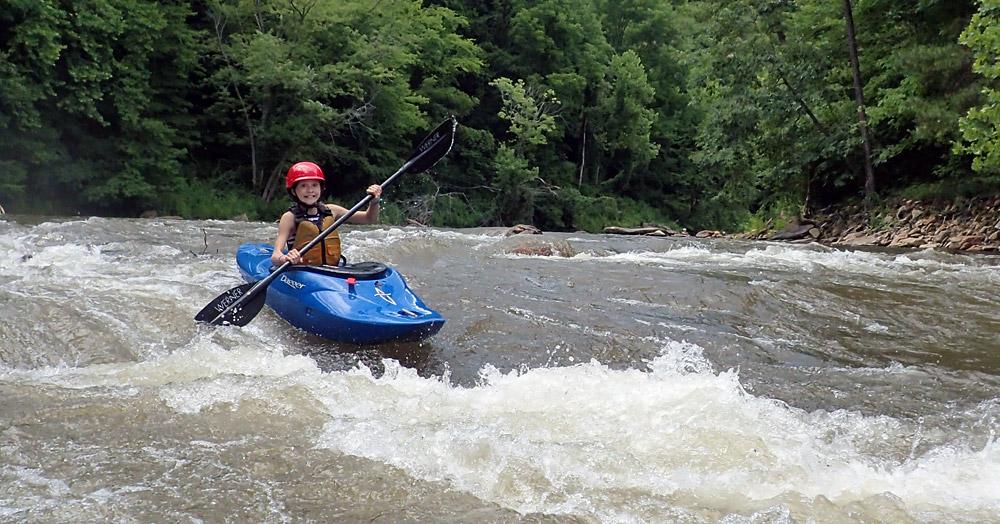 Girl kayaking in whitewater