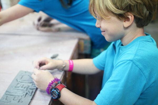 Kid pottery tile making