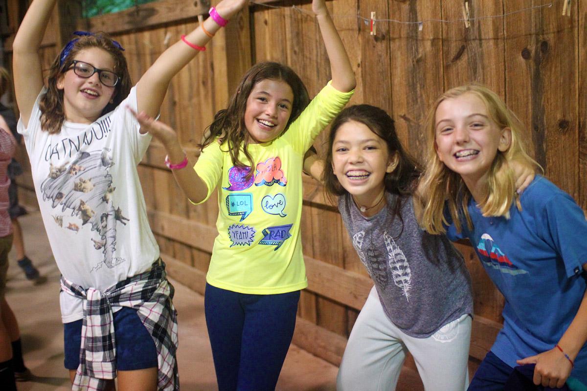 Pre-teen girls at summer camp dance