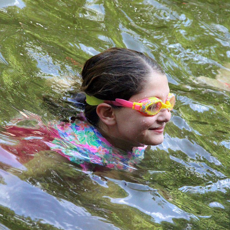 Girl swimming with goggles