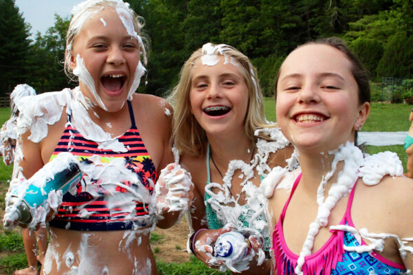 Camp girls shaving creamed
