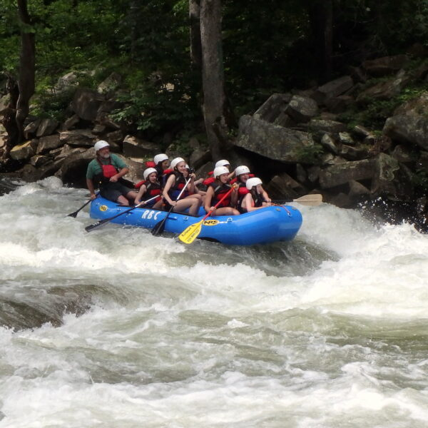 Camp kids whitewater rafting trip