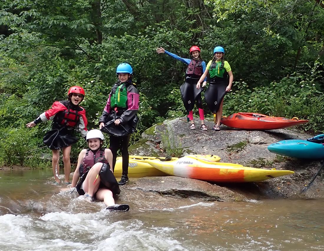 Girls kayaking camp fun in the rain