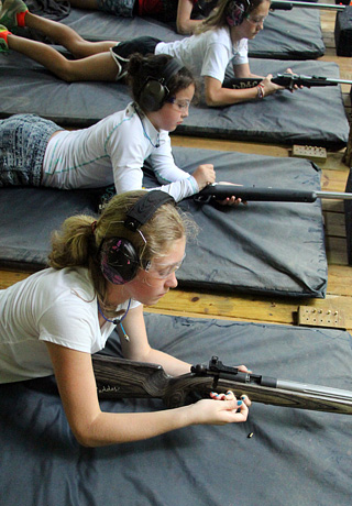Girls Loading Rifles