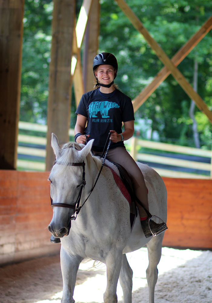 Camp horseback riding girl