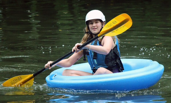 girl paddling coracle corcl