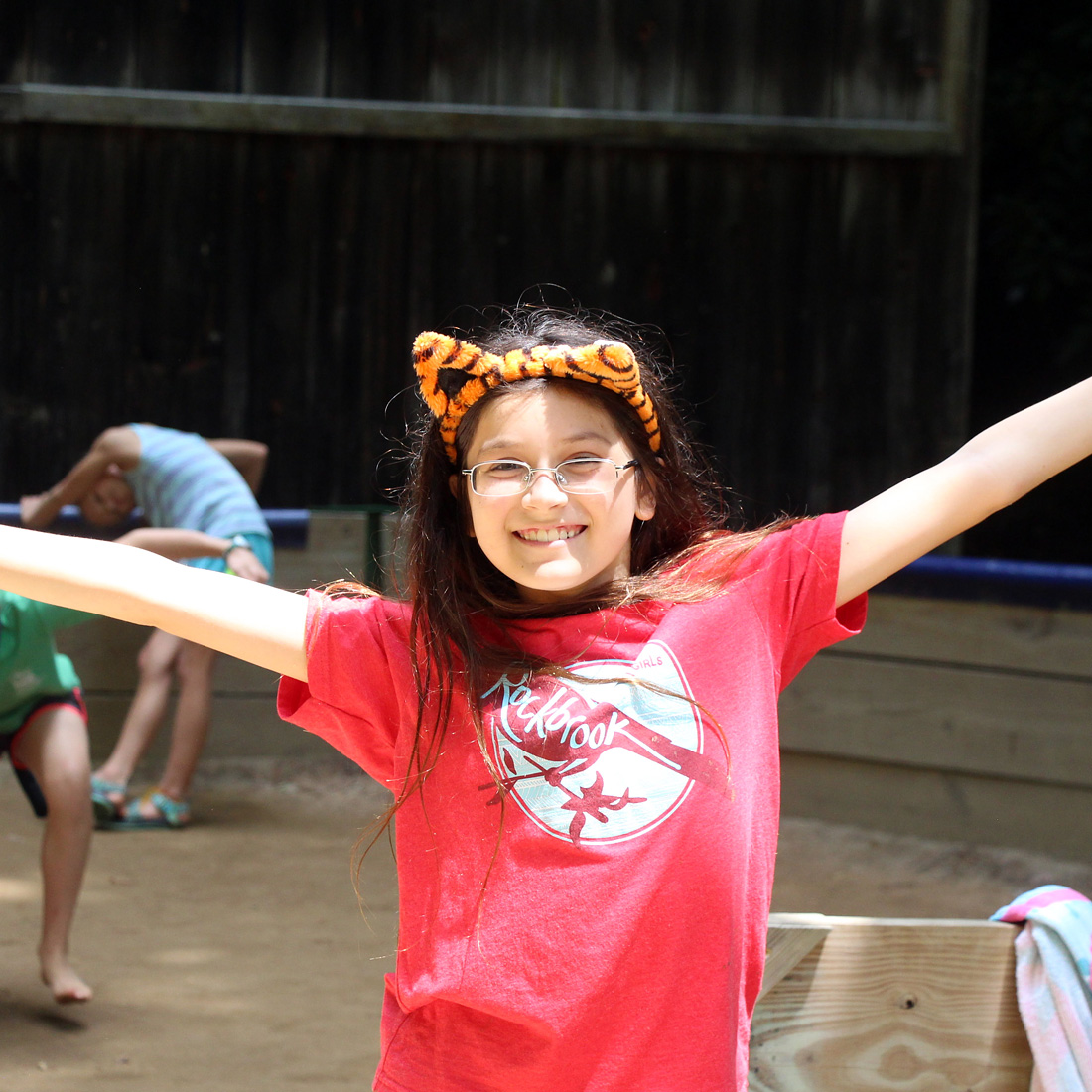 happy wide arms camp girl