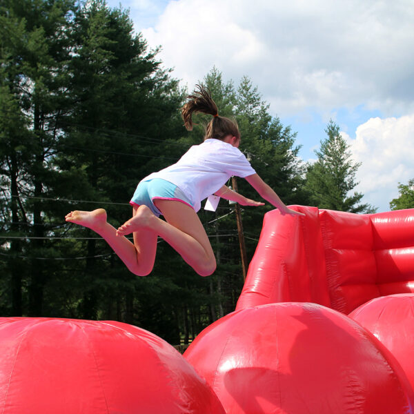 girl leaping obstacle