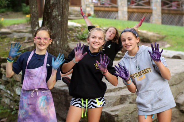 dyed hands from girls tie dyeing t-shirts