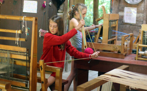 girls weaving looms