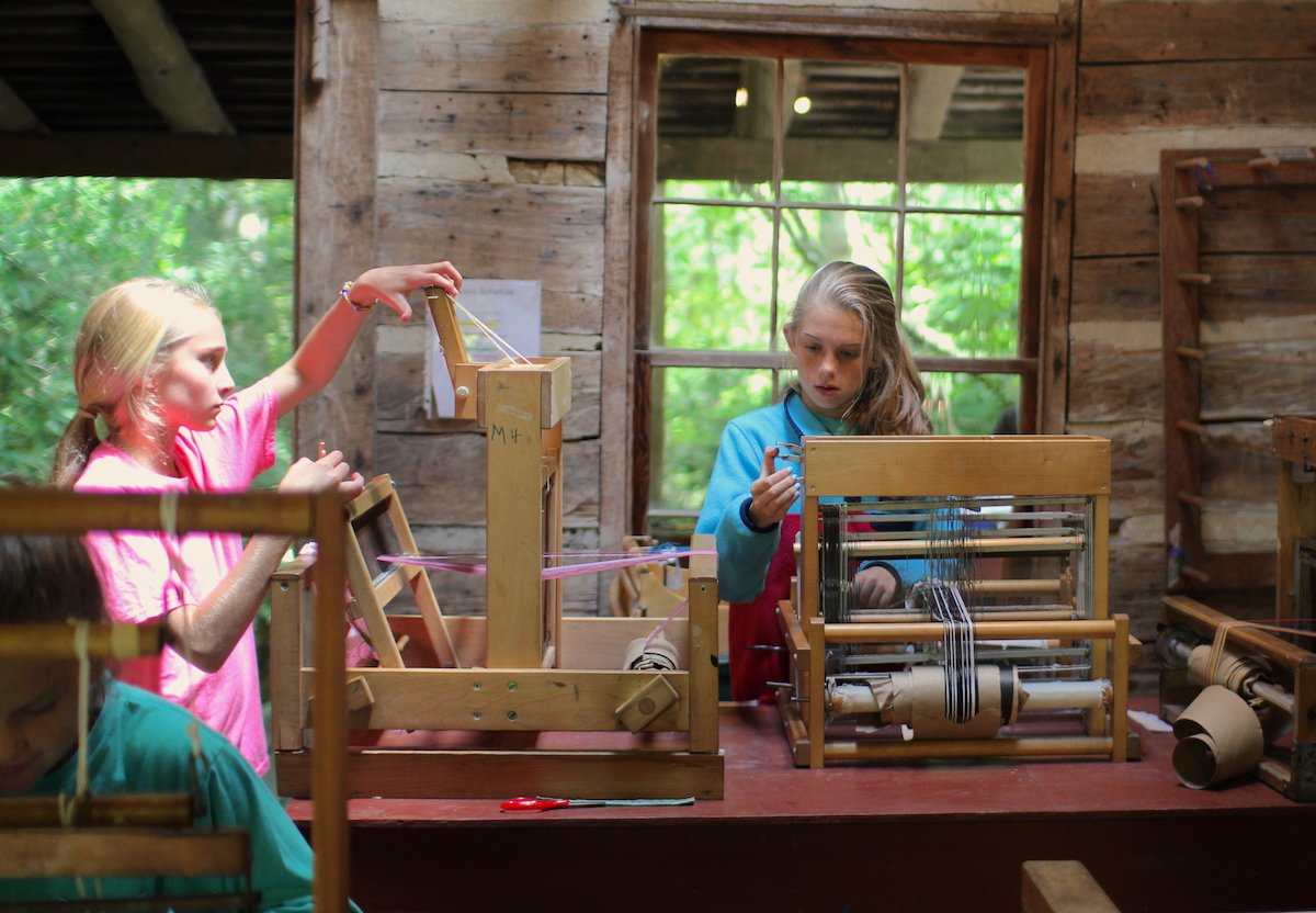 camp girls weaving