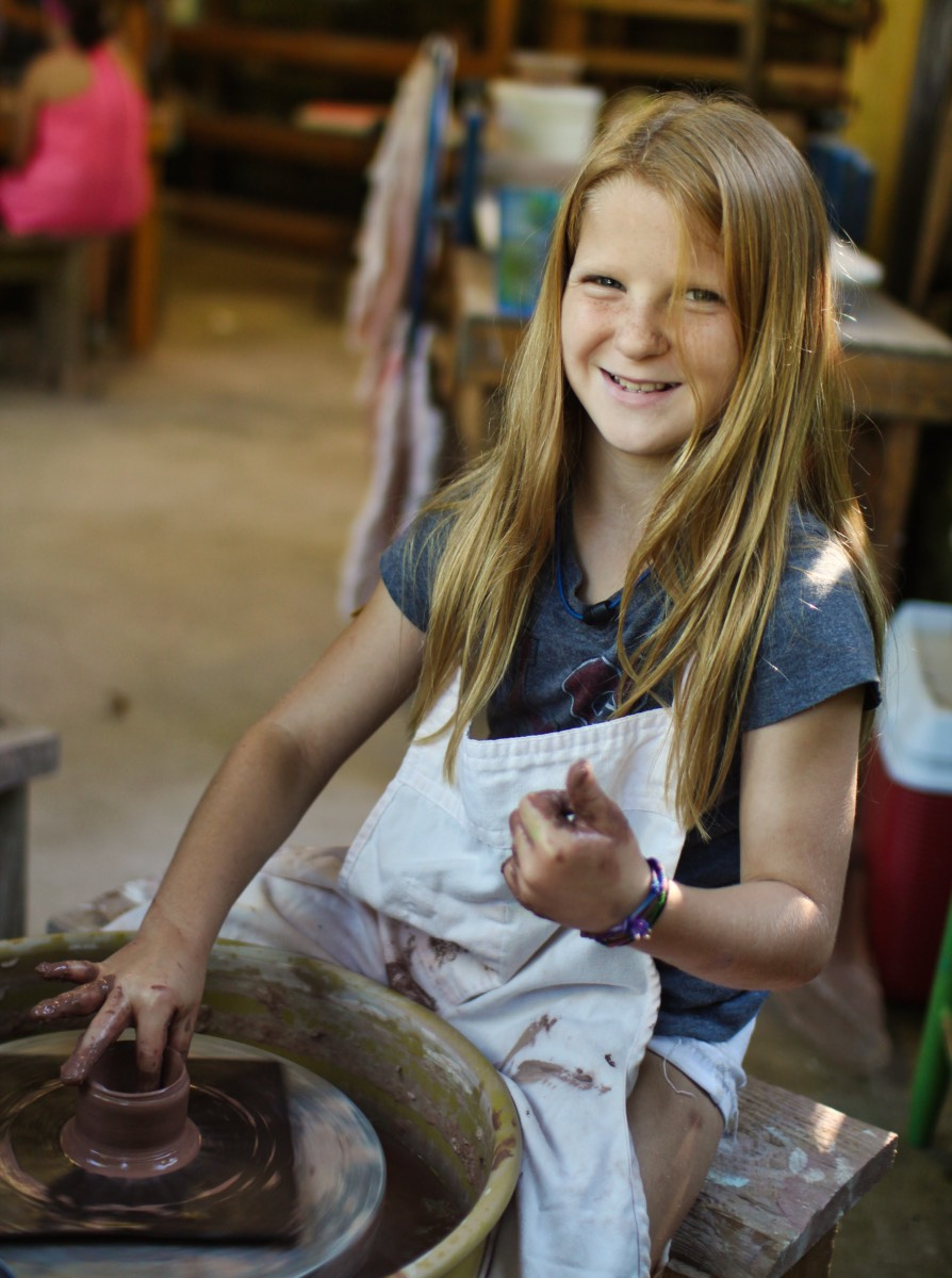 Smiling pottery wheel child