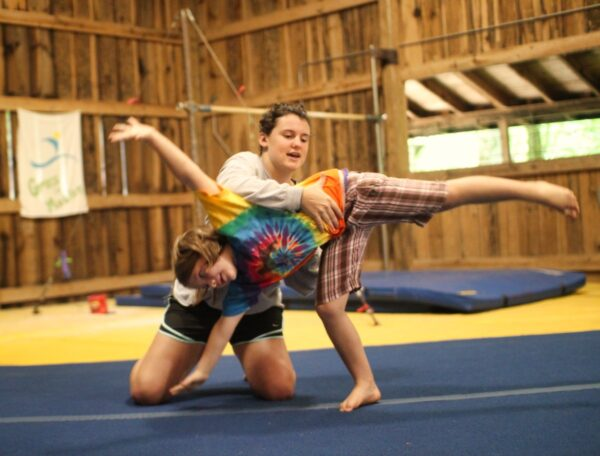camp girl learning cartwheel
