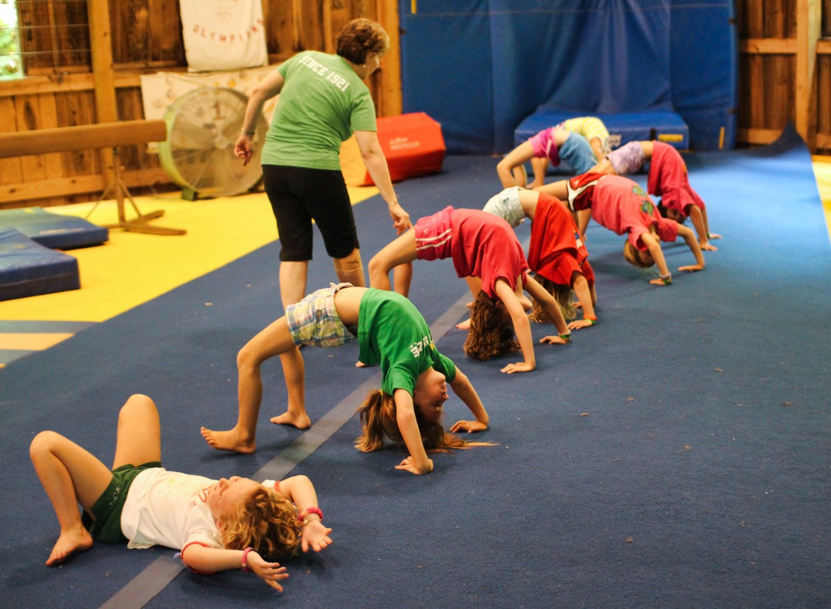 Groups of Camp girls doing gymnastics