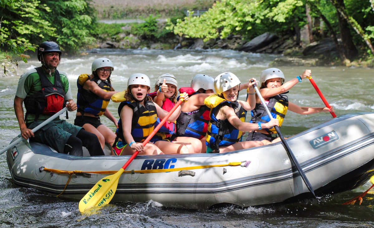 Camp crew whitewater rafting