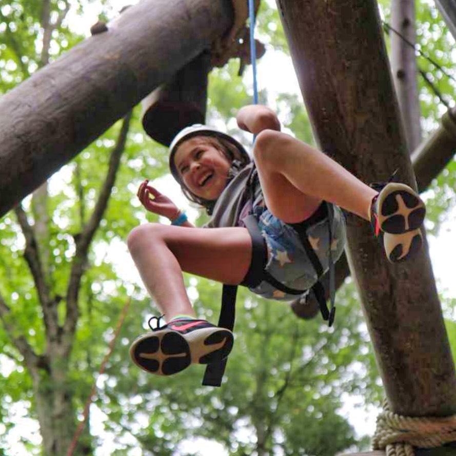 camp girl descending rope