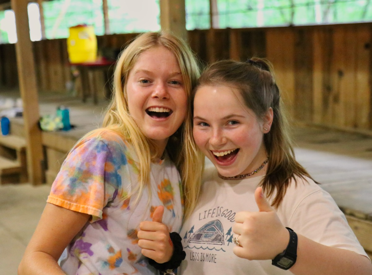 Camp friends thumbs up