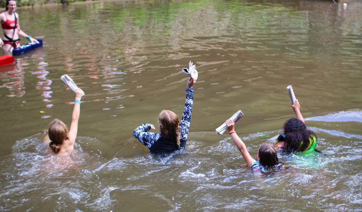 newspaper swimming relay race