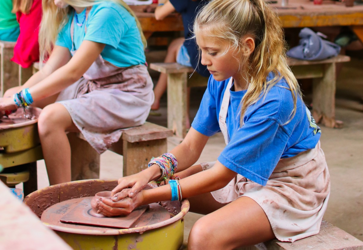 kid on pottery wheel