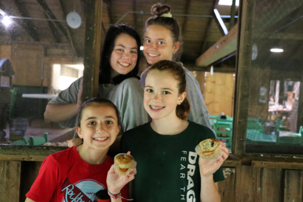 girls eating muffins at camp