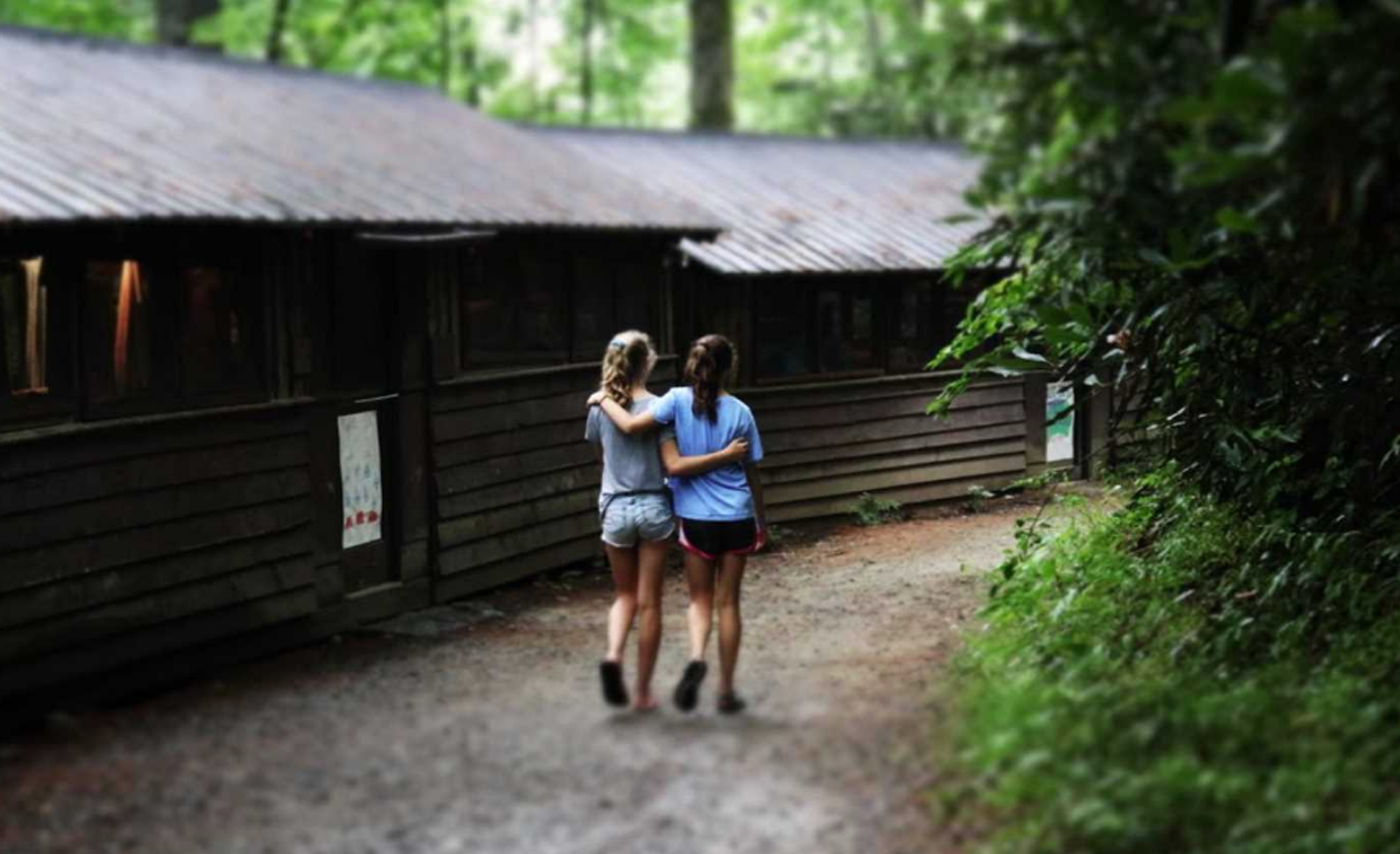 Girls arm in arm at summer camp
