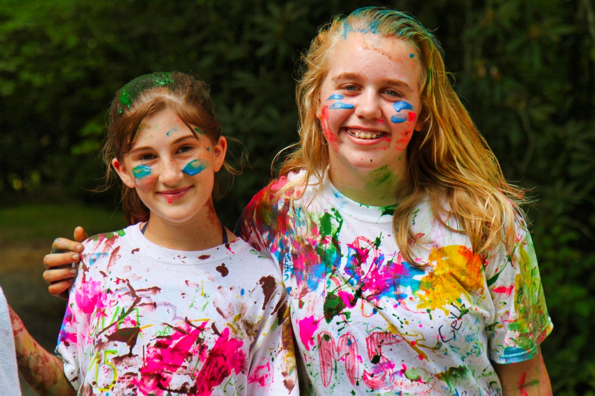 girls wearing t-shirts painted at camp