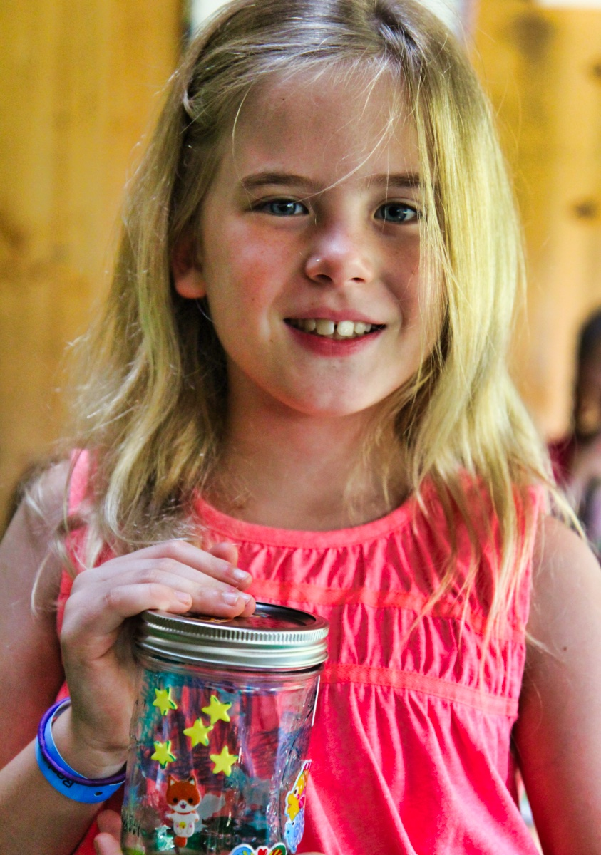 Decorated Jar held by summer camp girl