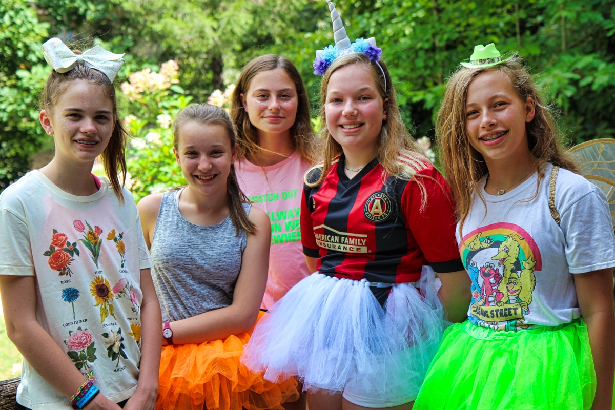girl camp kids dressed in costumes