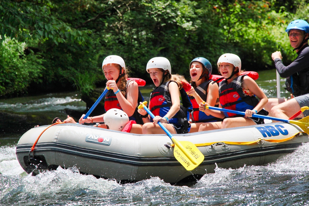 Girls Laughing in whitewater raft