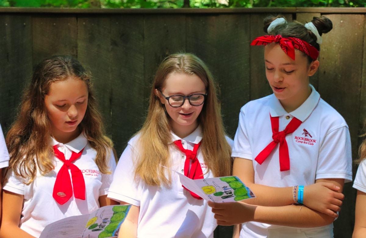 girls in camp uniforms