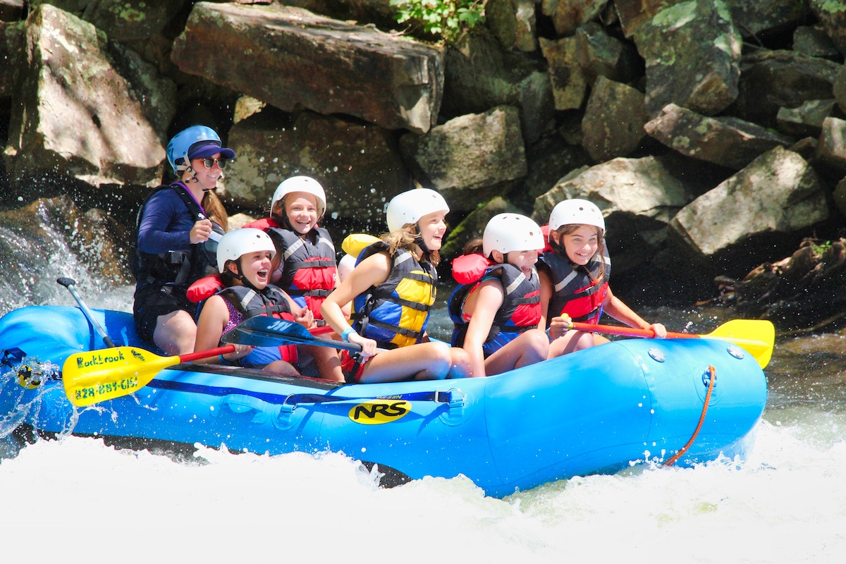 happy girl camp rafting