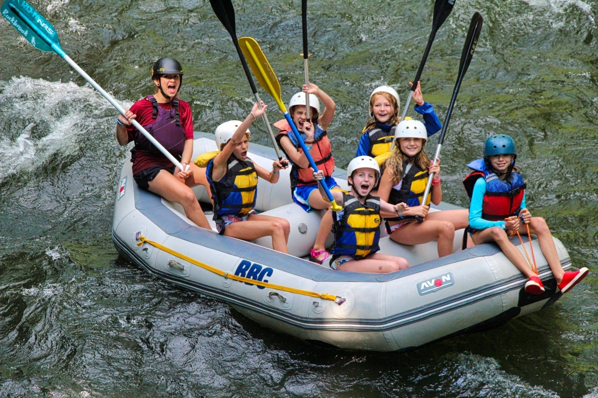 whitewater rafting boat cheering