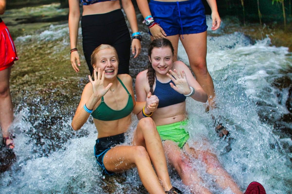 two girls waving before sliding rock