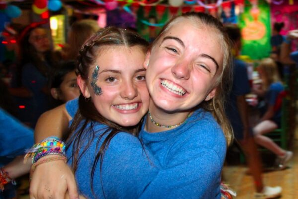 camp girls hugging at party