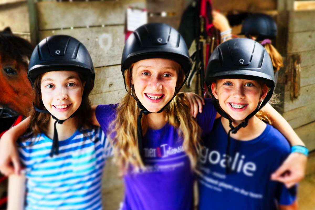 happy smiling horse riding girls