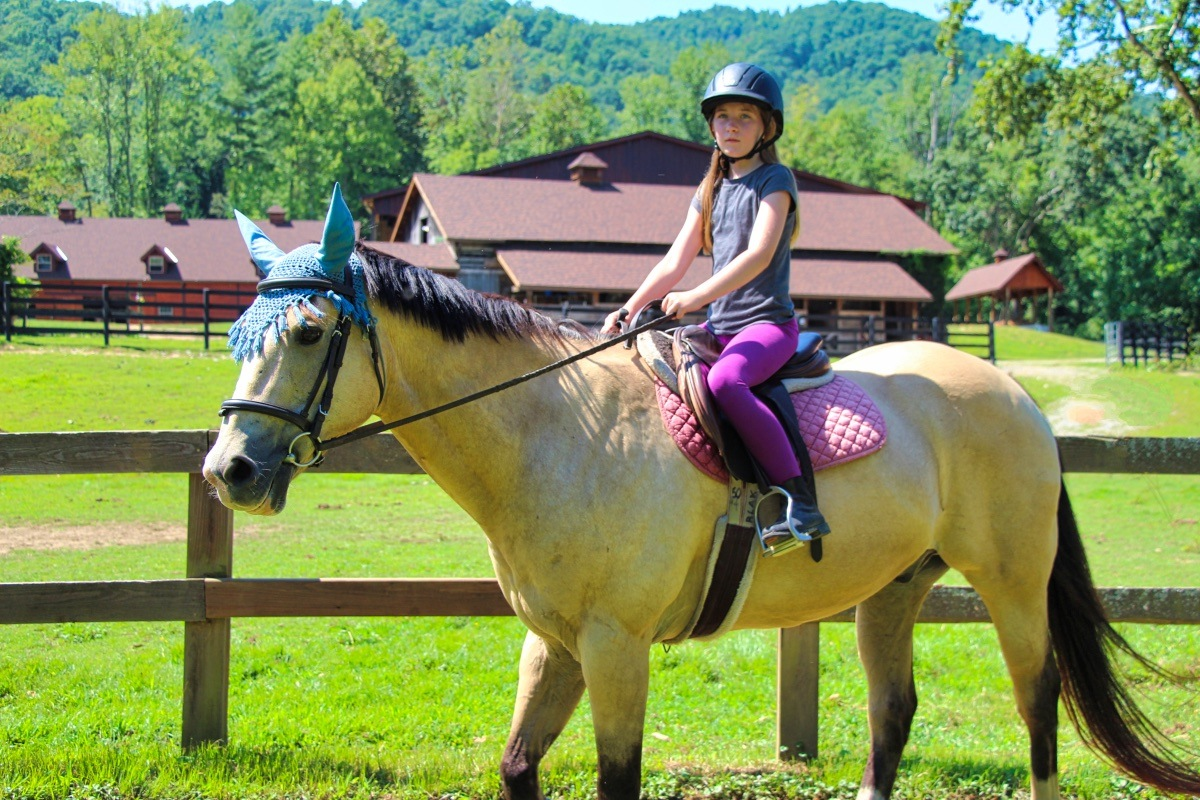 girl riding horse in the mountains