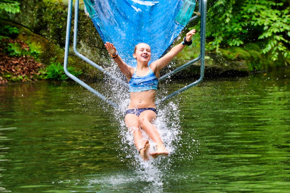 camp girls emerging from water slide