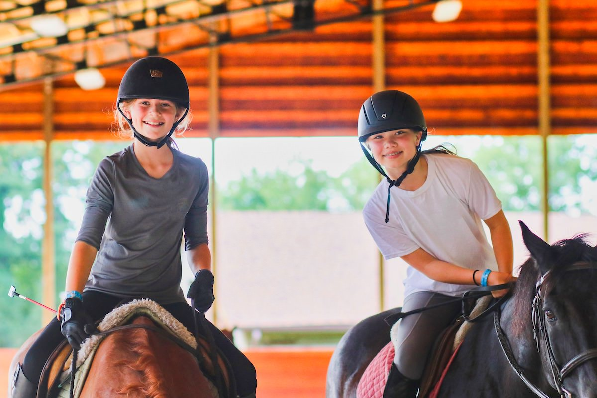 Advanced horsebacking riding camp girls