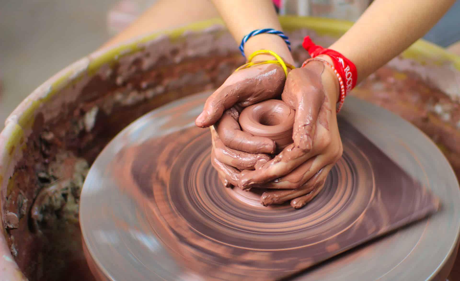 spinning pottery wheel at camp ceramics program