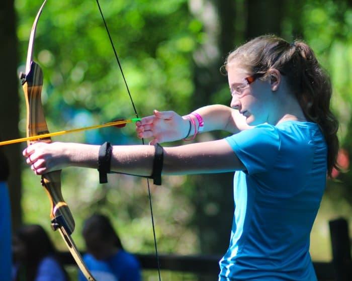 teenage girl shooting archery